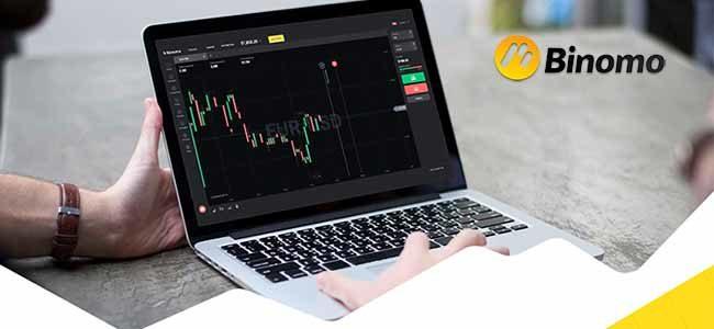 laptop with binomo platform
